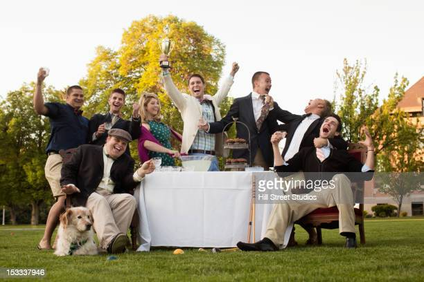 Friends enjoying elegant lawn party