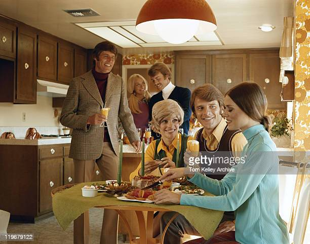 friends enjoying food party in kitchen - 1972 stock photos and pictures