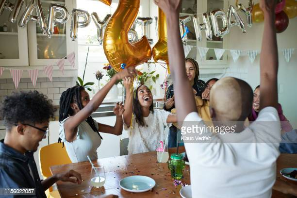 friends enjoying in birthday celebration at home - 21st birthday stock pictures, royalty-free photos & images
