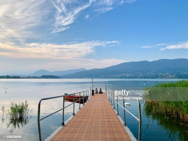 friends enjoying lake varese - varese stock pictures, royalty-free photos & images