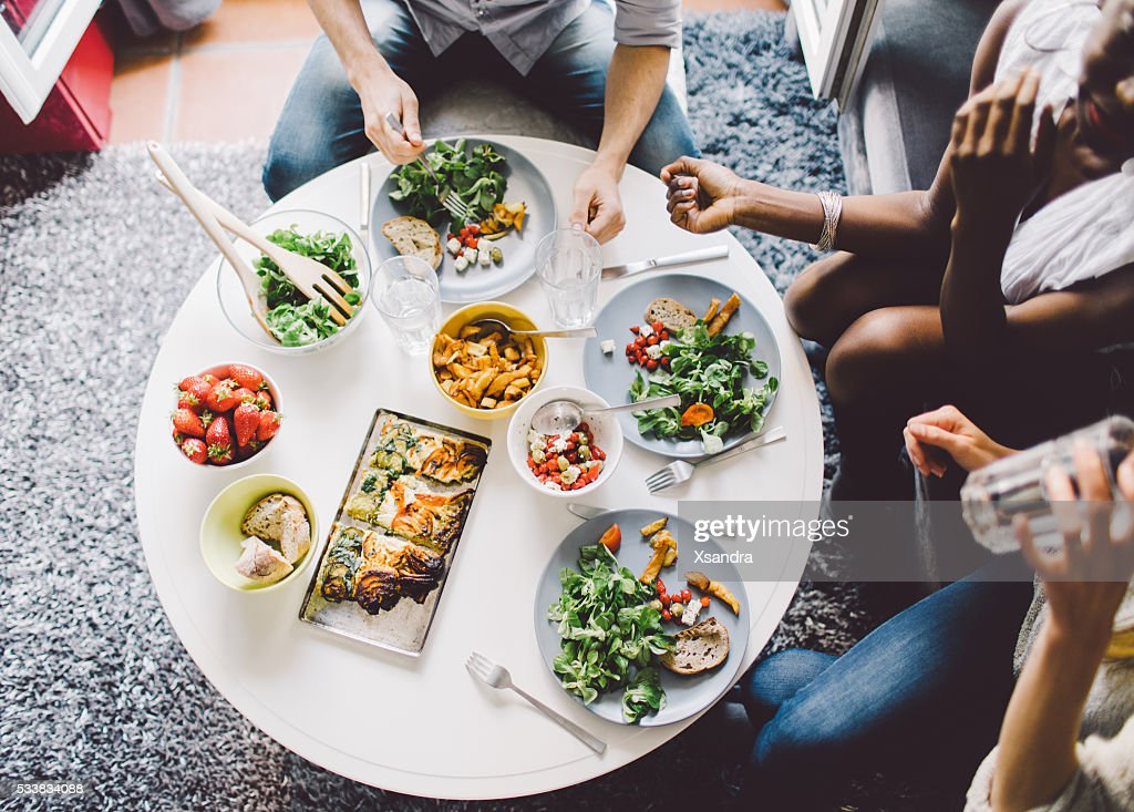 Friends enjoying lunch at home : Stock Photo