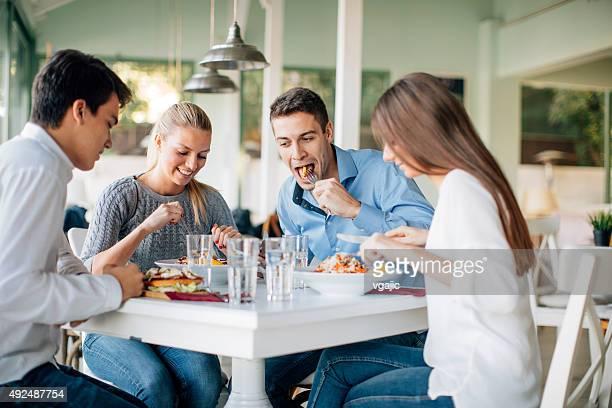 Friends Enjoying Lunch In Restaurant.