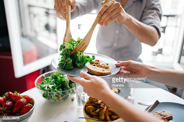 friends enjoying lunch - salad stock pictures, royalty-free photos & images