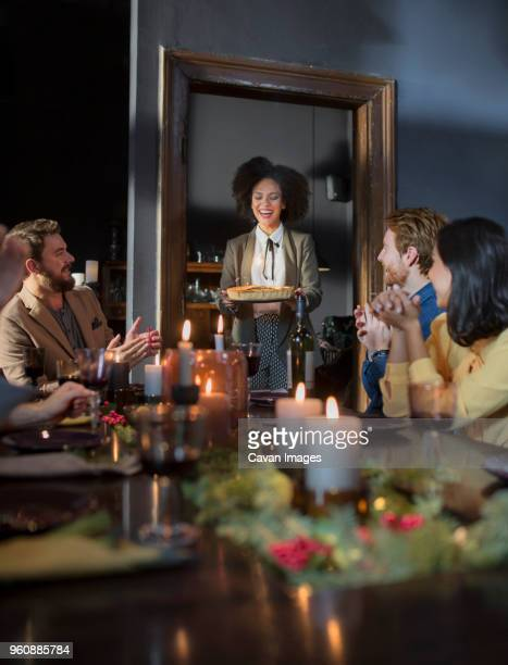 Friends enjoying meal during Christmas at home