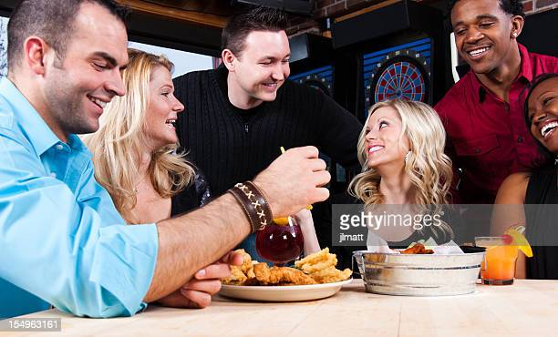 Friends Enjoying Night Out at Bar Restaurant