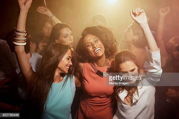 friends enjoying on dance floor at nightclub - entertainment club stock pictures, royalty-free photos & images