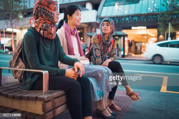 friends enjoying outdoors in city. - auckland stock pictures, royalty-free photos & images