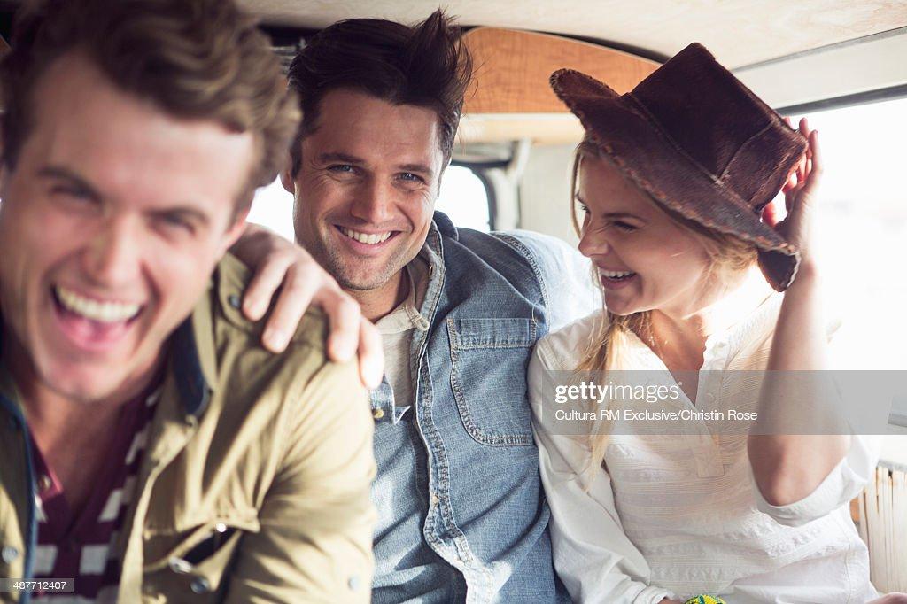 Friends enjoying road trip in a camper van : Foto de stock