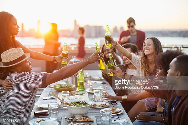 Friends enjoying rooftop party