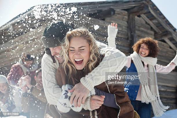 friends enjoying snowball fight - activiteit bewegen stockfoto's en -beelden