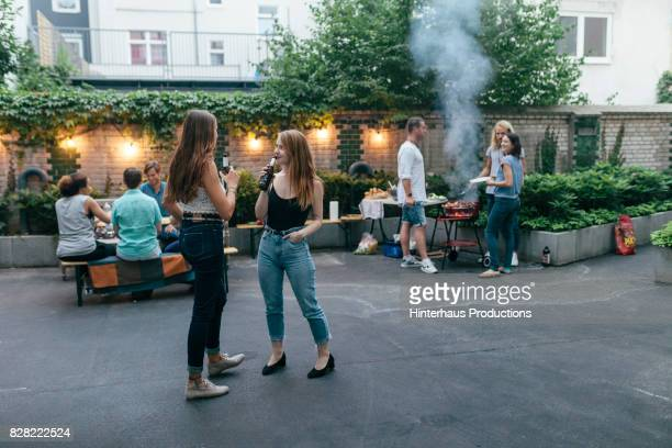friends enjoying summer evening barbecue together - men friends beer outside stock pictures, royalty-free photos & images