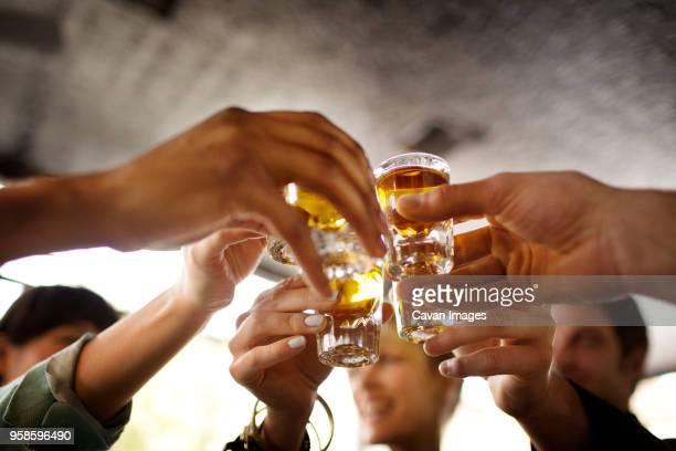 Friends enjoying tequila in bar