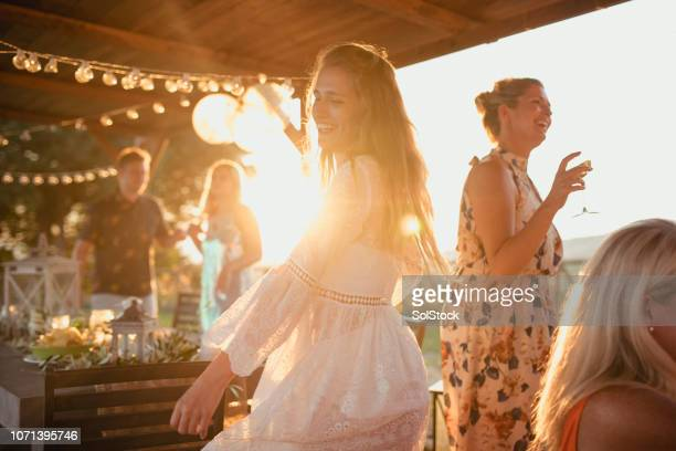 friends enjoying their evening - gazebo stock pictures, royalty-free photos & images