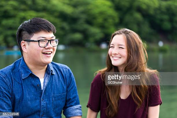 friends enjoying their weekend near a lake - chubby teen stock photos and pictures