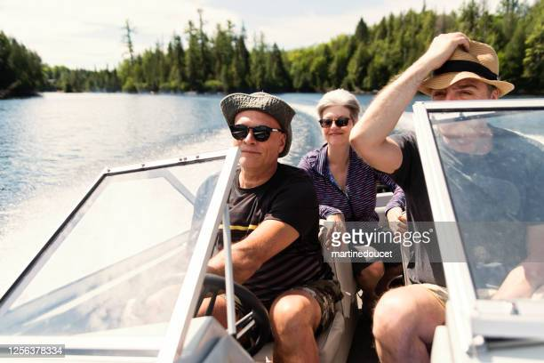 """50+ friends enjoying vacations on a small boat. - """"martine doucet"""" or martinedoucet stock pictures, royalty-free photos & images"""