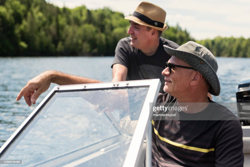 50+ friends enjoying vacations on a small boat. : Stock Photo
