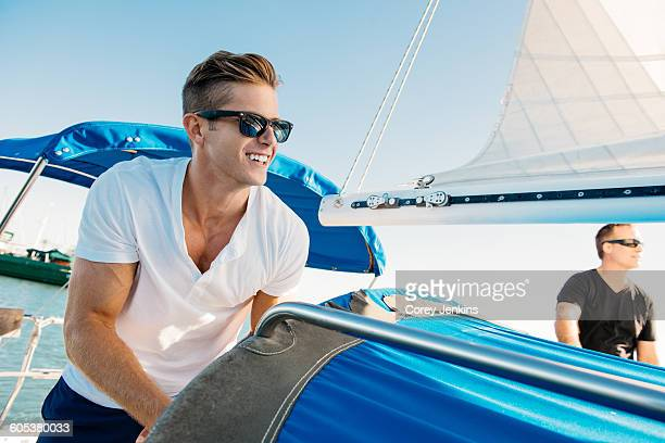 Friends enjoying view on sailboat