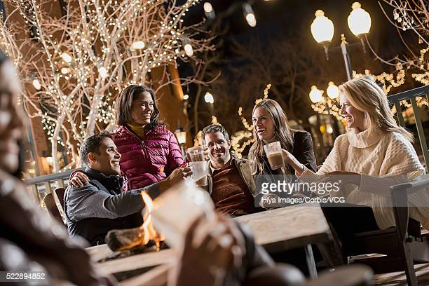 Friends enjoying winter evening in cafe