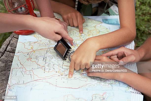 Friends examining map