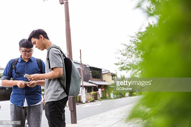 Friends exchanging cash