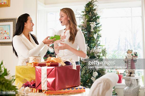Friends exchanging Christmas gifts