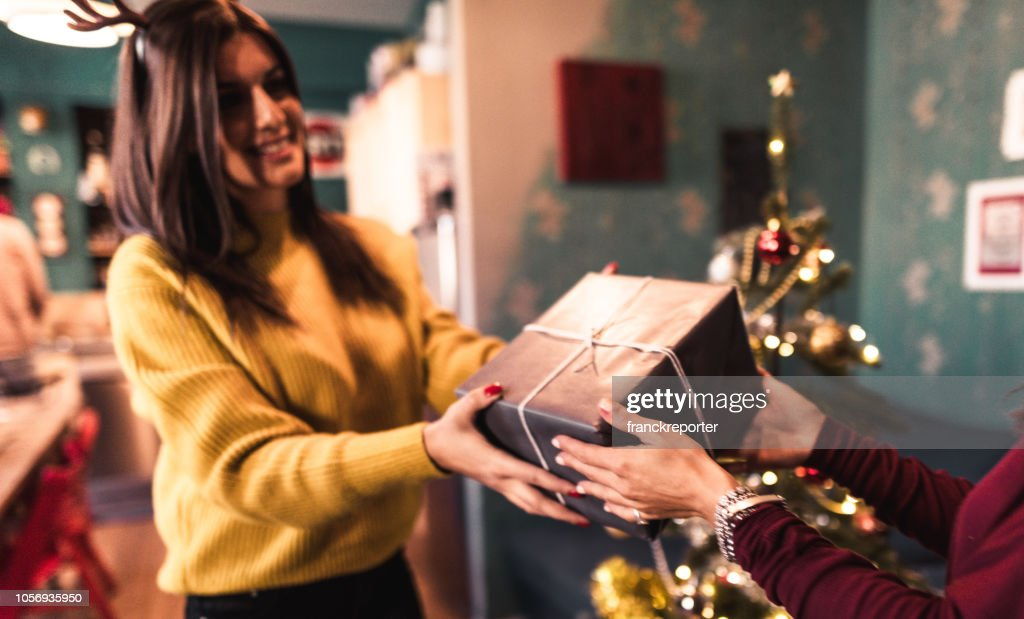 friends exchanging christmas presents : Stock Photo