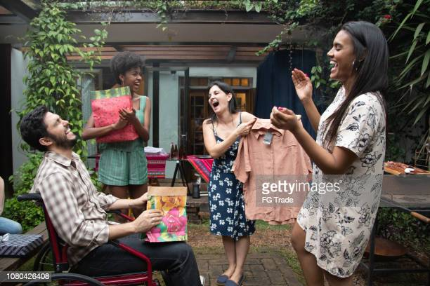 friends exchanging presents at get-together barbecue party - exchanging stock pictures, royalty-free photos & images