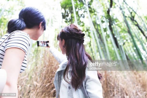 Friends exploring Arashiyama, Kyoto and taking selfie together