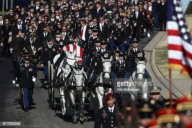 Friends family and colleagues follow the caisson carrying the casket of US Army Staff Sgt James F Moriarty during the soldier's burial service at...
