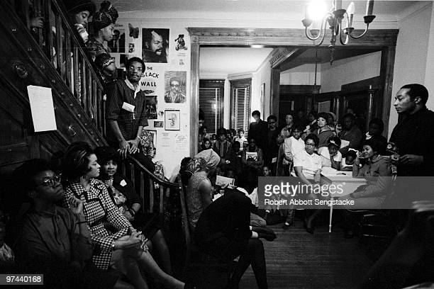 Friends family and fellow literary figures gather to celebrate poet Gwendolyn Brooks' 50th birthday at a gathering in her home Chicago 1967 Brooks is...