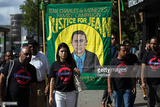 Friends family and supporters carry a banner as they arrive to attend a memorial to mark the 10th anniversary of the death of Jean Charles de Menezes...
