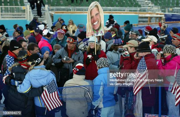 Friends, family and supporters of Jillian Vogtli of Ellicottville, New York hold giant photos of her and crowd around to take her photo after the...