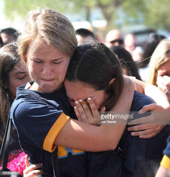 Friends family Florida International faculty and students mourn together during a vigil for victims of last week's pedestrian bridge collapse on...