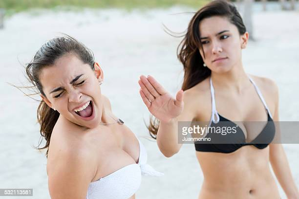 friends fighing - girl fight stock photos and pictures
