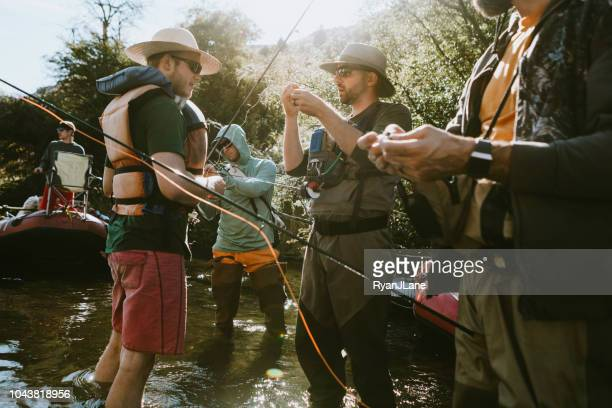 friends fishing on deschutes river rafting trip - fishing stock pictures, royalty-free photos & images