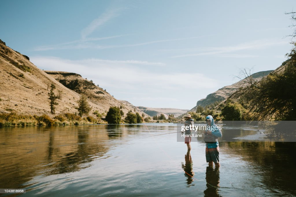 Friends Fishing On Deschutes River Rafting Trip Stock Photo - Getty