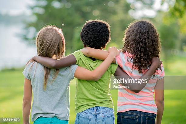 friends forever - green shorts stock photos and pictures