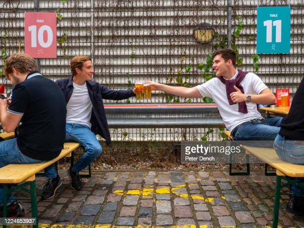 Friends from Bromley enjoy the vibe at Camden Town Brewerys pop-up beer garden on July 4, 2020 in London, United Kingdom. The UK Government announced...