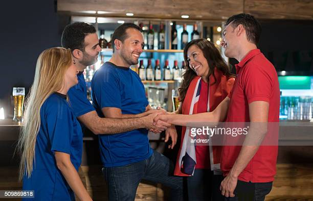 Friends from different teams at a sports bar