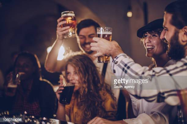 friends fun in pub - ale stock pictures, royalty-free photos & images