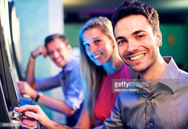 Friends gambling on slot machines