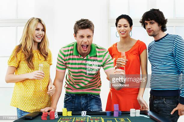 friends gambling - gambling table stock pictures, royalty-free photos & images