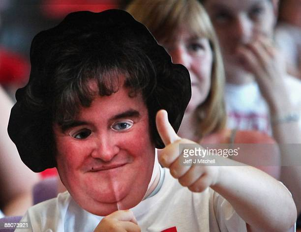 Friends gather at Blackburn community centre to watch singer Susan Boyle compete in the final of television show 'Britains Got Talent' on May 30 2009...