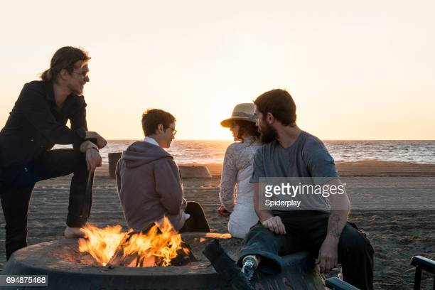 Friends Gathered Around Bonfire at the Beach