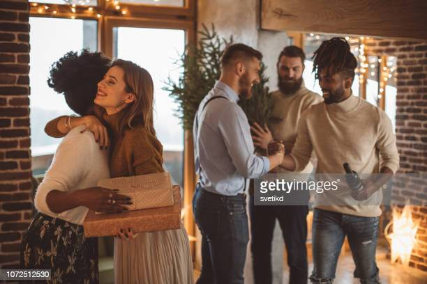 friends gathered for celebration. - party host stock pictures, royalty-free photos & images
