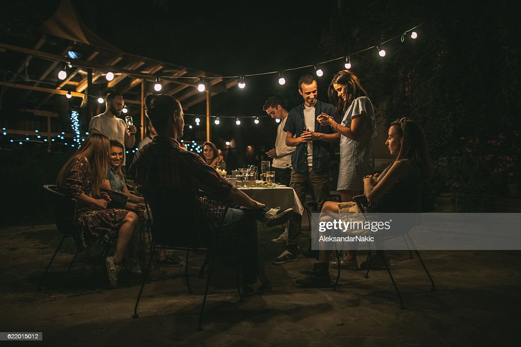 Friends gathered over dinner : Stock Photo