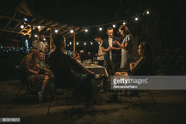 friends gathered over dinner - outdoor party stock pictures, royalty-free photos & images