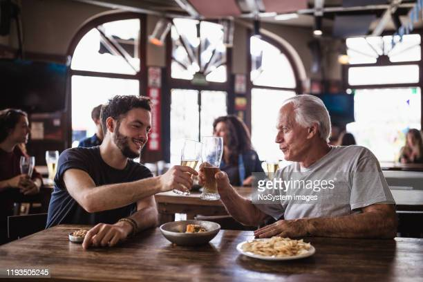 friends gathering in the pub, watching a soccer game - small group of people stock pictures, royalty-free photos & images