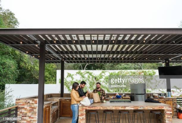 friends getting ready for a barbecue - carne assada imagens e fotografias de stock