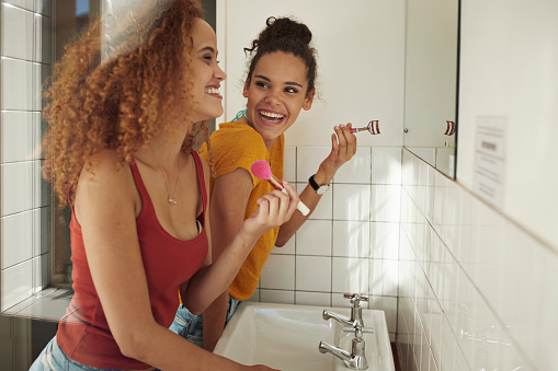 Friends getting ready in front of mirror in bathroom - gettyimageskorea